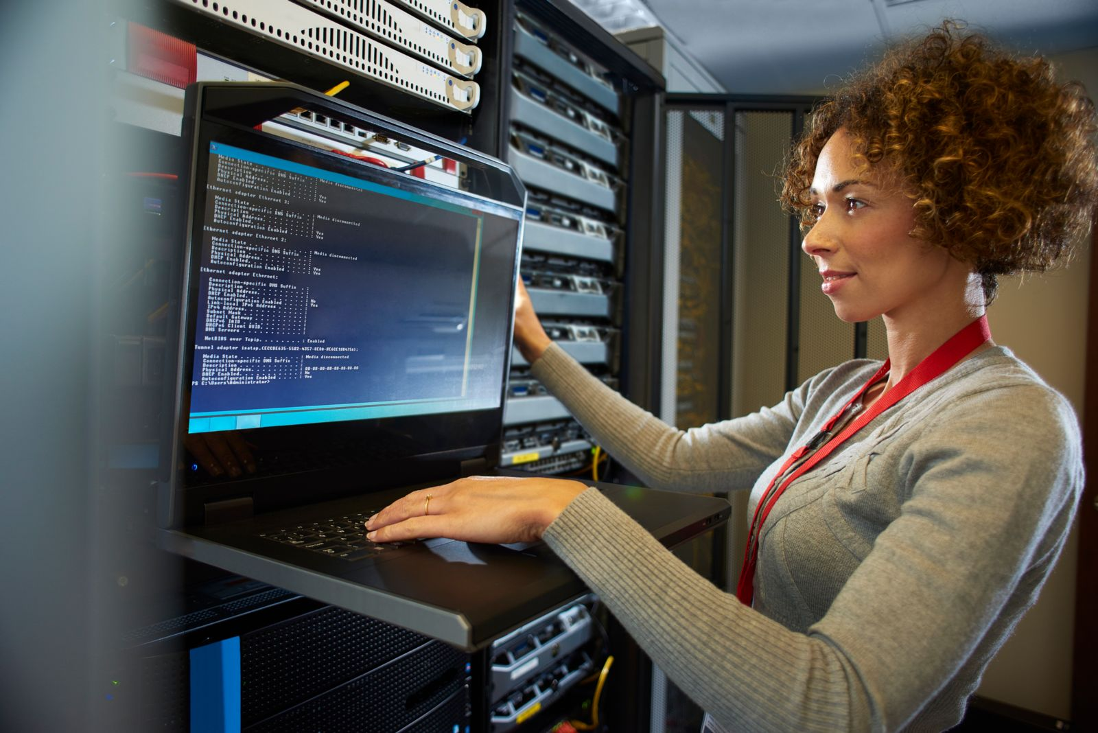 Female student working on computer server