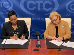 Vice Chancellor with Troy and CTC President sign the agreement.