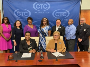 A group of leaders from Troy and CTC pose after the signing ceremony.