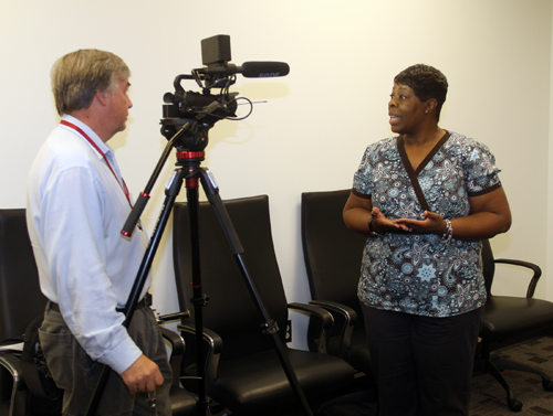 Columbus Ledger reporter Mike Haskey interviewing Sharron Cook